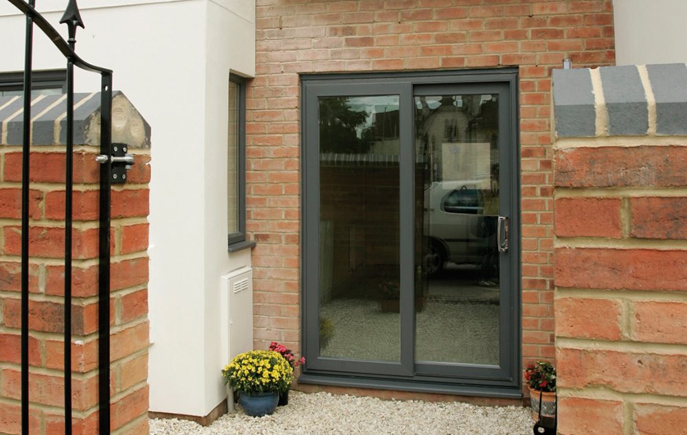 Upvc patio doors romford sliding doors essex upvc doors for Patio doors with windows that open